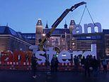 Popular 'I Amsterdam' sign that proved a hit with tourists is removed from Dutch capital