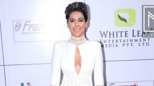 Nia Sharma in this sheer gown makes white look sexy like no one else