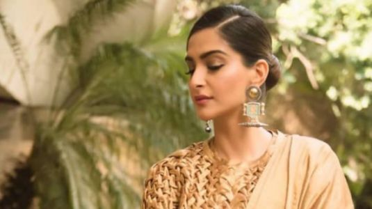 Sonam added a twist to a gold saree and we didn't see it coming