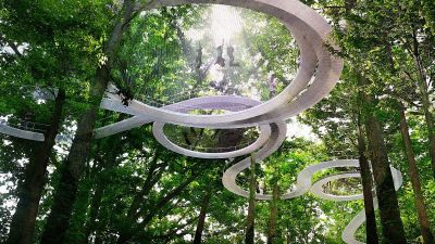 Behold the plans for a magical forest park with a giant trampoline in the trees