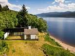 Pitlochry bungalow with two private beaches on Scottish loch up for sale for £460,000