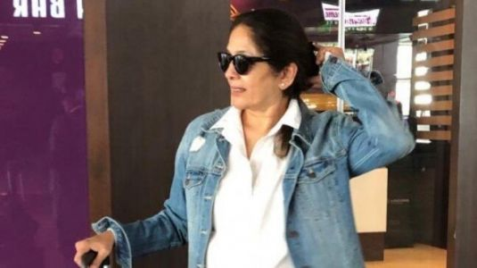 Neena Gupta makes heads turn at the airport in classic white shirt and ripped denims. See pic