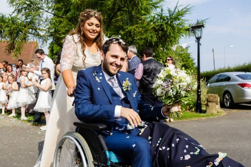 Man who shattered his leg in a bike crash six days before his wedding gets married in a wheelchair
