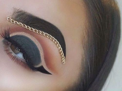 Stick a chain under your brows to break free from the eternal ennui of beauty trends