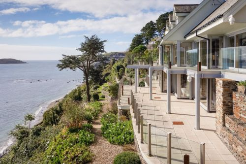 Take a look at this stunning £2.95 million home built onto the side of a cliff