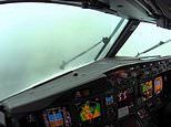 Nerve-wracking footage from the cockpit shows pilots landing during a thunderstorm