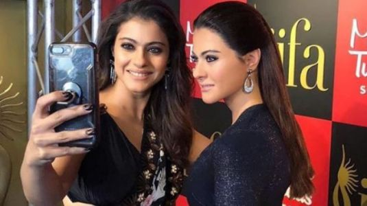 Let Kajol in this black saree teach you a thing or two about fusion dressing