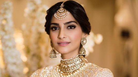 Sonam and Anand have us gasping for breath in ivory and gold at their sangeet