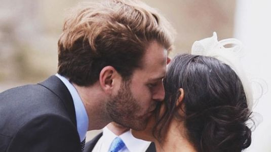 Who is this man kissing Meghan Markle on her cheek?