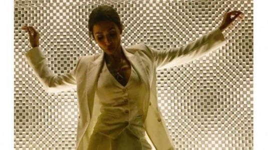 Malaika Arora looks undeniably hot in regal white power suit. Boyfriend Arjun Kapoor agrees