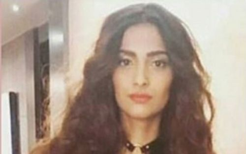 Never thought we'd say this, but Sonam Kapoor's gold outfit is hurting our eyes