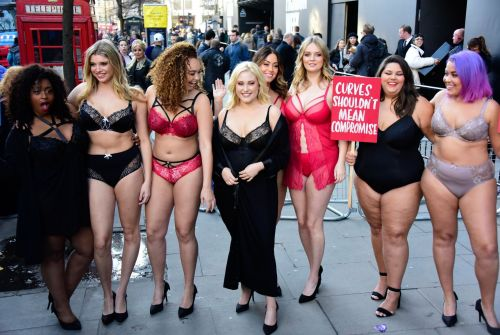 Plus-size women turn up to London Fashion Week in lingerie to protest the lack of curves