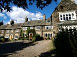 Street for hire! Holidaymakers can rent a whole ROW of luxury cottages in the Lake District