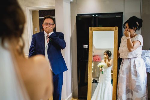 Photos capture the emotional moment parents see their daughter in her wedding dress