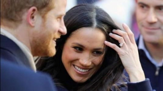 There's a reason Meghan Markle keeps touching her hair in public