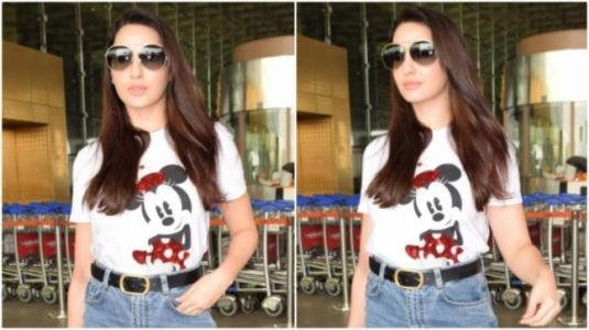 Nora Fatehi does the airport look right in casual top and denims with Rs 3 lakh bag
