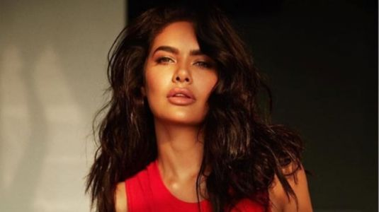 Esha Gupta does Supta Vajrasana at home with the cutest yoga partner. Can you guess who it is?