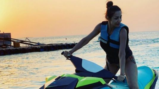 Malaika Arora in bikini on jet ski screams sexy in Maldives throwback image
