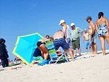 Beach umbrella is driven through a British woman's leg in New Jersey