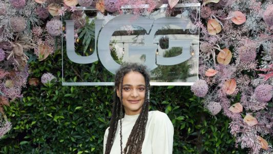 Sasha Lane Makes a Strong Case for the Wearability of These Fluffy Pink Ugg Slides