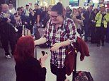 Hundreds watch a woman propose in Gatwick Airport