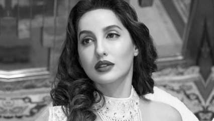 In Pics: Nora Fatehi goes from channelling old Bollywood charm to donning bold gown in less than 24 hours