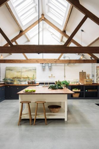 A MODERN SHAKER KITCHEN IN AN OLD UK CATTLE SHED