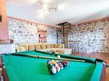 The Airbnb image that fooled guests into thinking they'd booked a rental with a big pool table.
