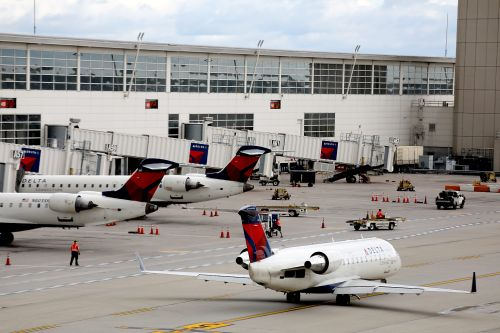 Delta flight returns to gate, delayed after two passengers refuse to wear face masks