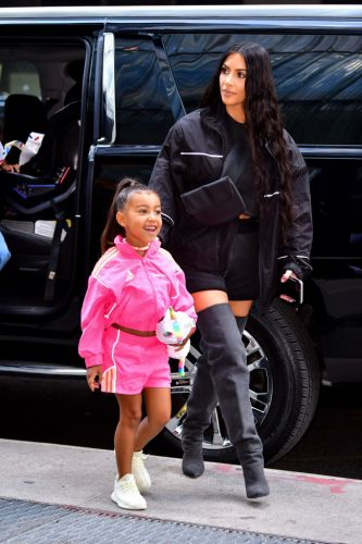Kim Kardashian Slammed for Straightening North West's Naturally Curly Hair