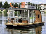 The luxury 'boat home' that comes with its own SAUNA