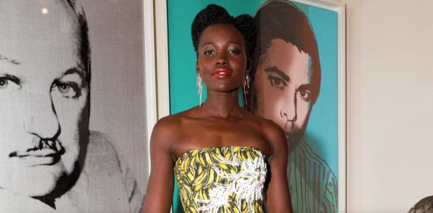 Lupita Nyong'o Mixed Banana Prints and a Disco Ball Clutch to Flawless Effect