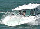 Sunbathers get a soaking when huge wave engulfs the bow of their $306k yacht off Miami