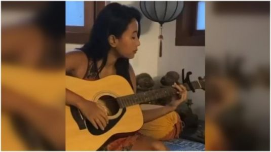 Milind Soman's wife Ankita Konwar plays guitar, sings her rendition of Adele's Someone Like You. Watch