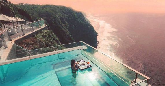 Dreamy cliff-side pool has a glass floor that overlooks the Indian Ocean