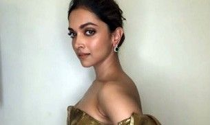 Deepika Padukone looks priceless in this thigh-high slit, golden gown