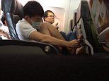 Stomach-churning moment passenger picks his TOENAIL on a busy flight to Vietnam