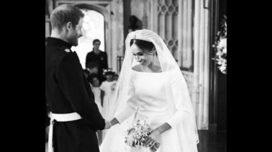 New mommy Meghan Markle and Prince Harry celebrate first anniversary. Share BTS images from wedding