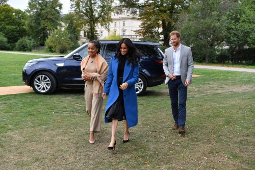 Watch Prince Harry Smooth Out Meghan's Hair