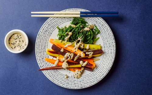 Steamed carrots and tops with tahini miso dressing