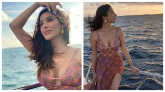 Sophie Choudry is vacation fashion goals in pink cut-out dress. Sultry pics