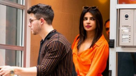Priyanka Chopra paints NYC tangerine in plunging neckline dress with hubby Nick Jonas. See pics