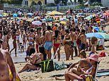 Beachgoers pack sands of Portugal as coronavirus cases rise after UK axed country from green list