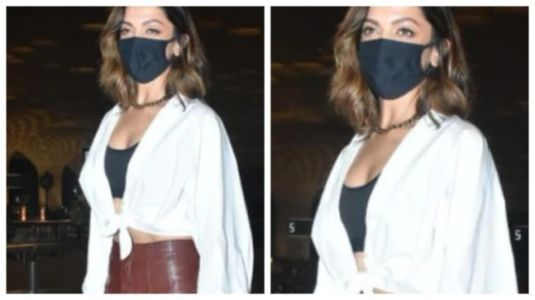 Deepika Padukone in faux leather pants and white blouse nails an uber-stylish airport look. Watch