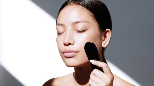 How To Give Yourself A Gua Sha Facial At Home