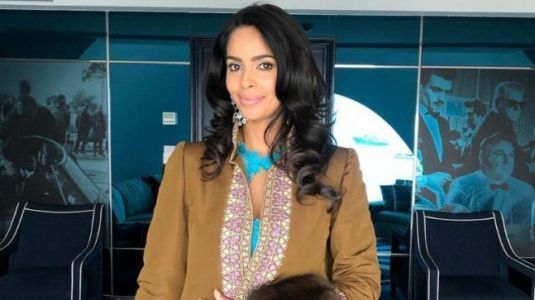 Cannes 2019: Mallika Sherawat screams fashion disaster in tan jacket and lacy blue gown. See pics