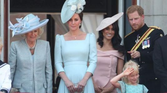 Why did Meghan Markle stand behind Kate Middleton for her first balcony appearance?
