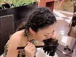 Revolting footage shows Chinese woman eating a bat as scientists link coronavirus to the animal