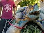 Anti-tourism protesters in Spain chain themselves to Gaudi's iconic dragon